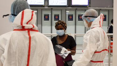 A passenger is tested upon arrival at Roissy Charles de Gaulle airport in Paris. Travellers entering France from 16 countries where the coronavirus is circulating widely are having to undergo tests upon arrival at French airports. Even so, France has just been added to a quarantine list for Norway.