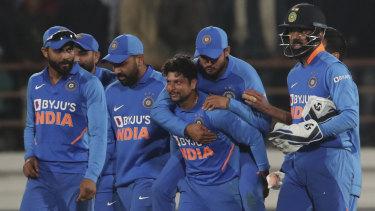 India celebrate the dismissal of Steve Smith for 98 in Rajkot.