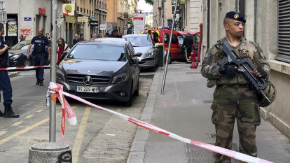 Suitcase bomber sought over blast in Lyon