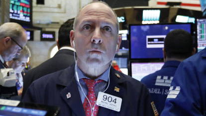US stock indexes edge mostly lower as retailers sink