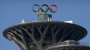 Olympic rings are visible atop the Olympic Tower in Beijing.
