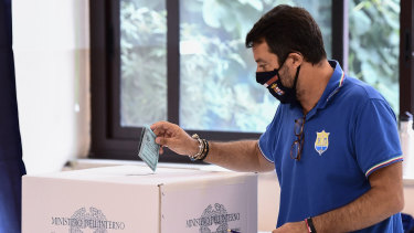 Right-wing opposition leader Matteo Salvini casts his ballot in a polling station in Milan, Italy.