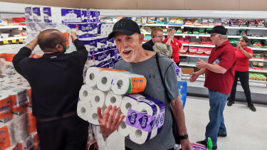People receiving toilet paper, paper towel and pasta at Coles.