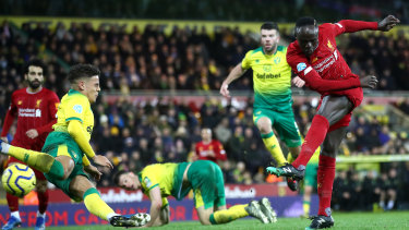 Sadio Mane of Liverpool breaks the deadlock against Norwich City at Carrow Road.