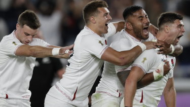 Dominant: England celebrate their upset over New Zealand at International Yokohama Stadium.