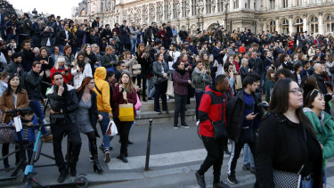 Parisians watched as flames and smoke rise from Notre-Dame cathedral.