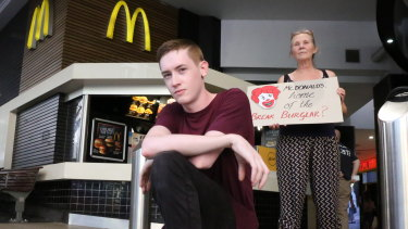 Noah Nicholson and Michelle Beavis protest for better working conditions at McDonald's in Brisbane