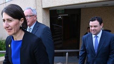 Premier Gladys Berejiklian with Stuart Ayres, right, and fellow minister Brad Hazzard last year.