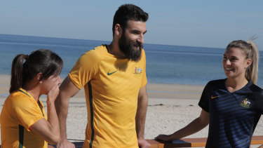 Former Socceroos captain Mile Jedinak with Matildas stars Lisa De Vanna and Steph Catley.