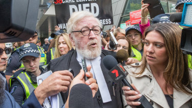 Cardinal Pell's lawyer speaks outside court on Wednesday.