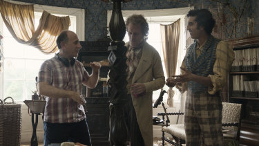 Armando Iannucci with Hugh Laurie and Dev Patel on the set of The Personal History of David Copperfield.
