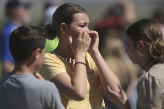 Students react in horror after a school shooting at Rigby Middle School in Rigby, Idaho on Thursday.