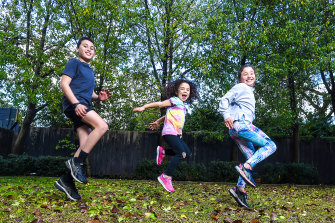 Alex, Hattie and Georgie Gurvich doing their regular backyard exercises. Georgie misses sports and is training for cross country by running with her dad.