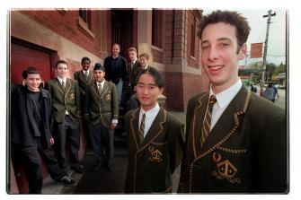 Trinity Grammar students including Piers Mitcham, right, were instrumental in getting Nelson Mandela to visit Australia in 2000.