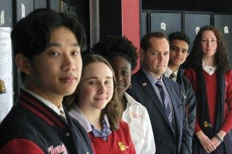 Reservoir High school students Andy Ngo, Hayley Corneille, Rumbi Mutezos, Dhruv Verma and Charlotte Reginato, with principal Andrew McNeil.