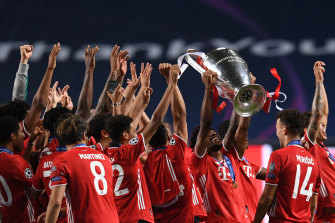 Coman lifts the Champions League trophy with his Bayern teammates.