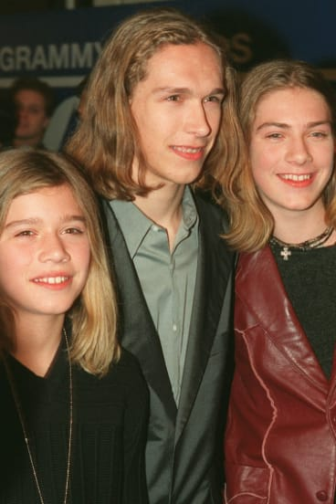 Hanson, from left, Zac, Isaac, center, and Taylor, arrive at Radio City Music Hall in New York, for the 40th annual Grammy Awards in 1998.
