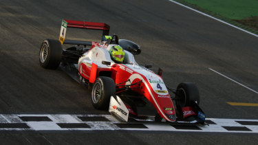 Mick Schumacher and his winning vehicle.