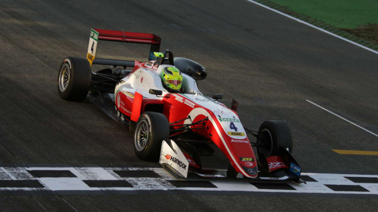 Mick Schumacher and his winning vehicle.