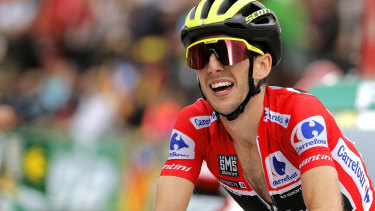 Michelton-Scott's Simon Yates won a historic first grand tour for the Australian team on Sunday.