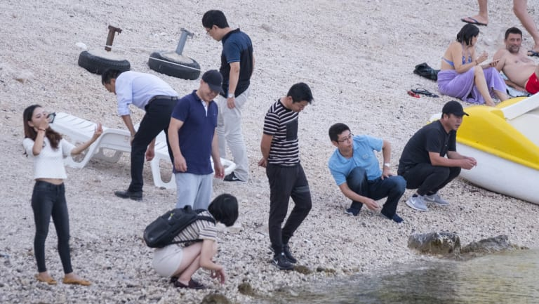 Chinese workers on a public beach in Komarna, Croatia, near the site where a bridge connecting Dubrovnik to the rest of Croatia will be built.