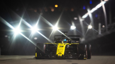 Night rider: Ricciardo driving his Renault during qualifying for the F1 Grand Prix of Singapore at the Marina Bay Street Circuit.