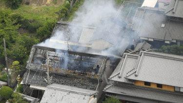 Smoke rises from a house blaze in Takatsuki, Osaka, following an earthquake on Monday.