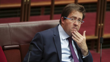 Senator James McGrath during debate in the Senate at Parliament House.
