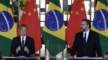 Chinese Foreign Minister Wang Yi, left, and Brazil's Foreign Minister Ernesto Araujo, take part in a joint press conference at the Itamaraty Palace, in Brasilia, onthe eve of the BRICS meeting.