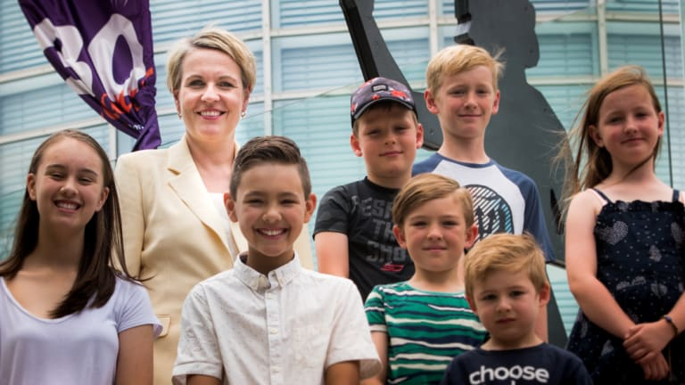 Deputy Opposition Leader Tanya Plibersek, pictured with school children at Questacon in Canberra, is urging universities to toughen their admission standards for teaching degrees or face a mandatory cap on student numbers under a Labor government.