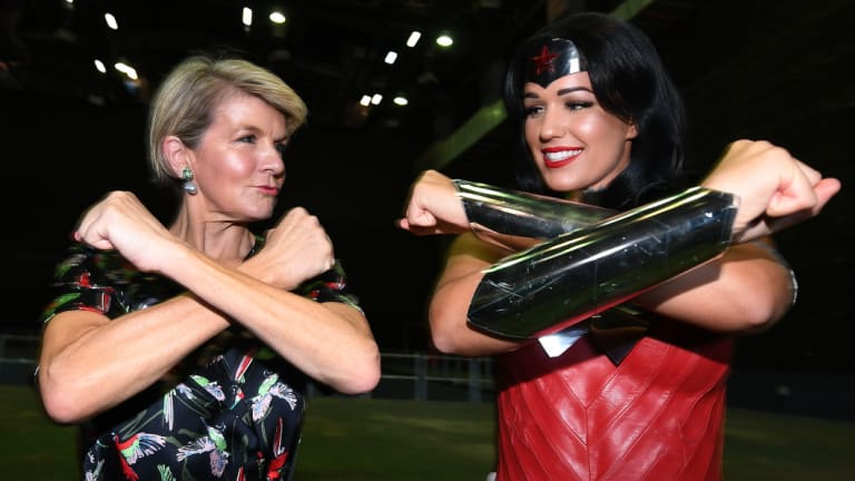 Foreign Affairs Minister Julie Bishop strikes a pose with Wonder Woman after announcing the funding boost at Village Roadshow Studios on the Gold Coast.