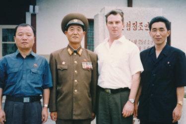 Criminal solicitor Jack Dalziel (second right) with Jon Hak-bom (far right) and Kim Chu-nam (far left)