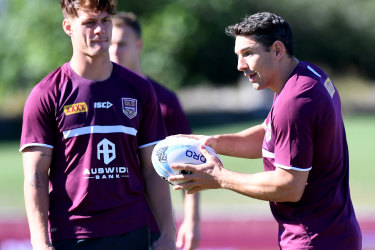 Billy Slater gives Kalyn Ponga some pointers in Maroons camp in 2019.