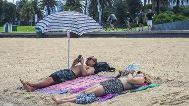 Many went maskless at St Kilda beach on Tuesday.
