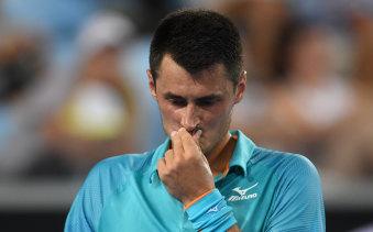 No joy: Bernard Tomic made an early exit from the Australian Open last night.