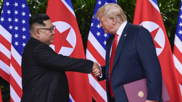 North Korean leader Kim Jong-un, left, and US President Donald Trump shake hands at the conclusion of their meetings on Sentosa Island in Singapore in June 2018.