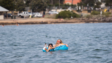 Chilling out at Williamstown beach on Tuesday.