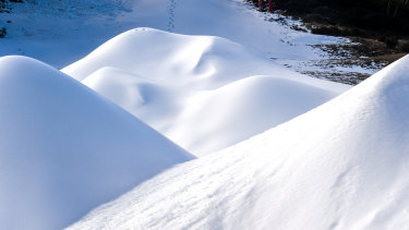 Mounds of artificially created snow at Mount Baw Baw.