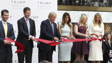 New generation: Donald Trump and family members cut the ribbon at the opening of the  Trump International Hotel in Washington in 2016.