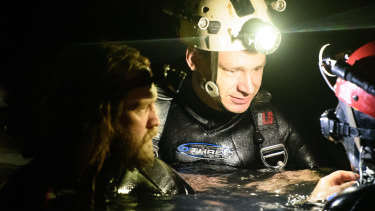 Cave divers Jim Warny (yellow helmet),and Erik Brown (left) play themselves in The Cave, the first film to document the extraordinary rescue of the Thai boys soccer team from Tham Luang cave in July 2018.