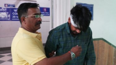 Hit-run driver Puneet Puneet (right) leaves court with his uncle in Dehli on Friday.