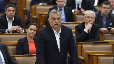 Hungarian Prime Minister Viktor Orban replies to an oppositional MP during a question and answer session of the Parliament in Budapest, Hungary.