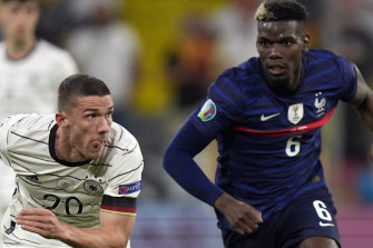 France superstar Paul Pogba, right, followed Ronaldo's lead by removing a Heineken bottle during a press conference.