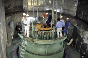 Technicians work in the reactor of Iran's Bushehr nuclear power plant in a file picture, released by Iran's Atomic Energy Organization.