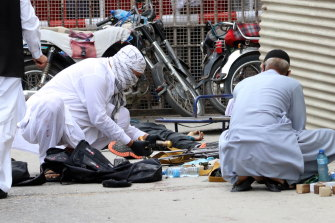 Pakistani security officials inspect weapons and ammunition recovered at the scene of the attack.