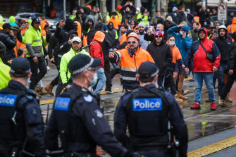 Police and protesters face off at the front of the CFMEU office on Elizabeth Street last week.