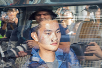 Murder suspect Chan Tong-kai inside a vehicle leaving Pik Uk Prison in Hong Kong.