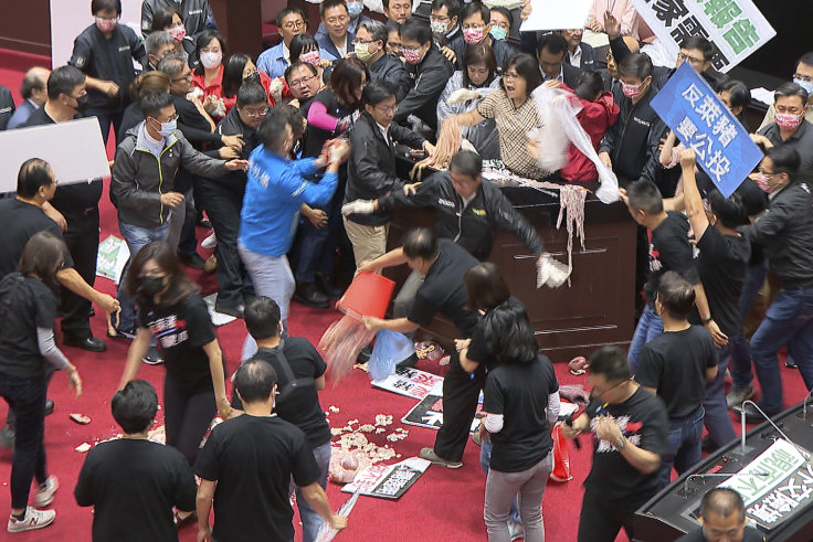 Fists and pig guts fly in Taiwan Parliament debate on US pork imports
