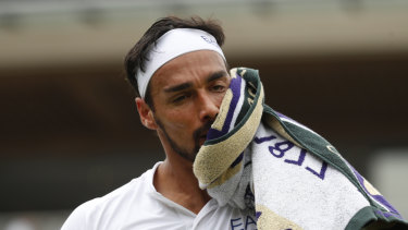 Repent at leisure: Italy's Fabio Fognini wipes his face as he plays United States' Tennys Sandgren.