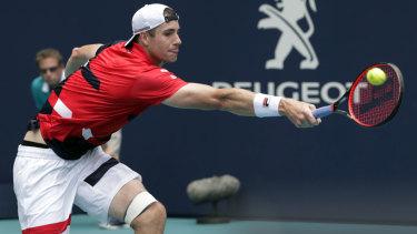 American John Isner injured his left foot, going down 6-1, 6-4 to Federer.